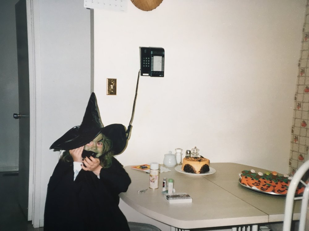 """I'm on an important witch call mother. Please exit the room before I turn your new push-button phone back into a rotary."""