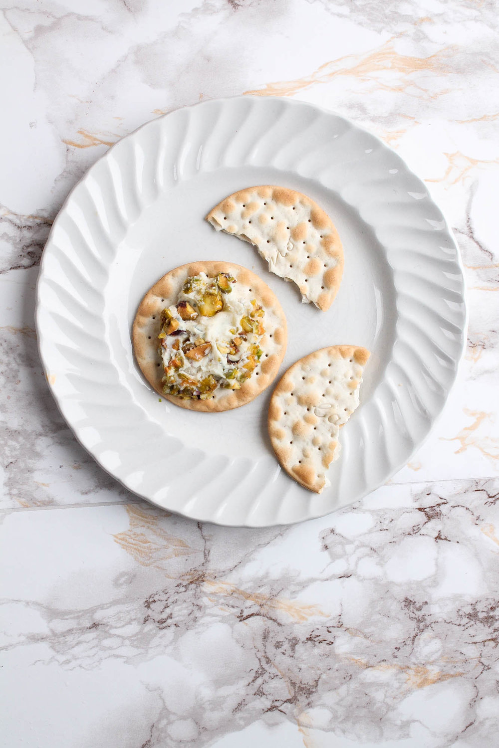 Stilton Pear Cheese Ball With Pistachios + Pink Peppercorns || This cheese ball is a perfect appetizer for a holiday party or dinner! Cream cheese, blue cheese, pear, pink peppercorns, pistachios + honey. Serve with crackers, bread, or vegetables. || creamandhoney.ca