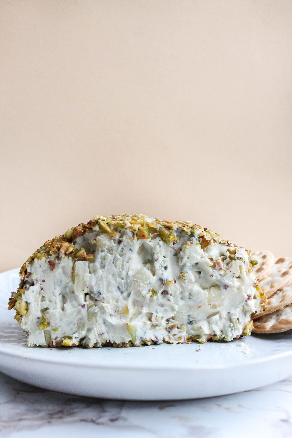 Stilton Pear Cheese Ball With Pistachios + Pink Peppercorns    This cheese ball is a perfect appetizer for a holiday party or dinner! Cream cheese, blue cheese, pear, pink peppercorns, pistachios + honey. Serve with crackers, bread, or vegetables.    creamandhoney.ca