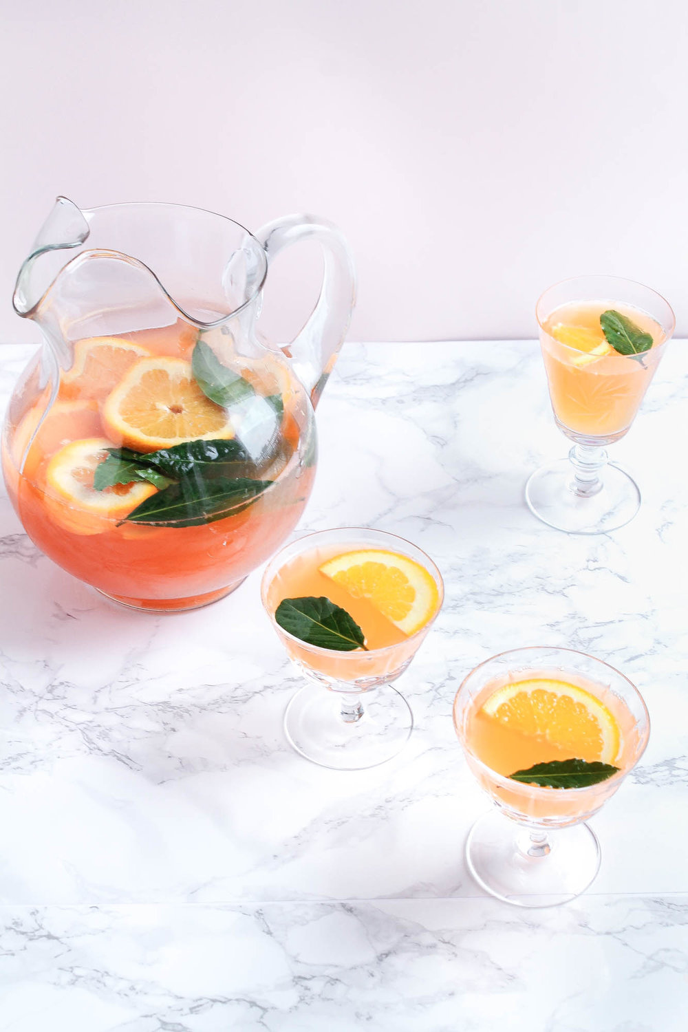 Amaro Spritz Punch    A delicious Christmas punch perfect for the holidays! This batch cocktail is made with sparkling wine, aperol, amaro montenegro, orange juice and gin. Fresh and light!    creamandhoney.ca