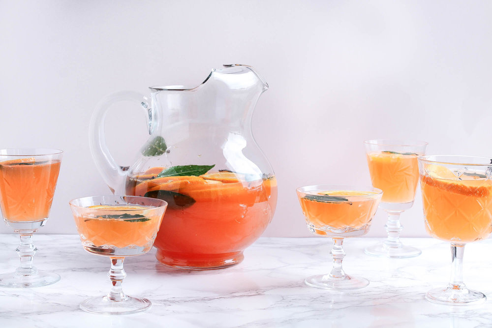 Amaro Spritz Punch || A delicious Christmas punch perfect for the holidays! This batch cocktail is made with sparkling wine, aperol, amaro montenegro, orange juice and gin. Fresh and light! || creamandhoney.ca