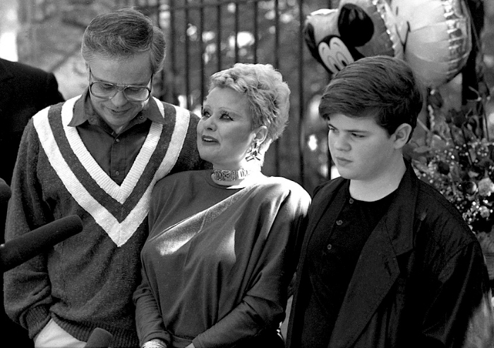 (Left to right) Televangelists Jim Bakker and Tammy Faye Messner with their son, Jay Bakker, in the 1980s.