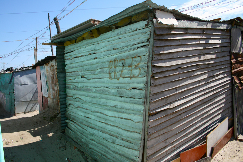 With few resources, people have erected shacks of wood, cardboard and corrugated tin, informal structures that now account for more than 50 percent of all homes here.