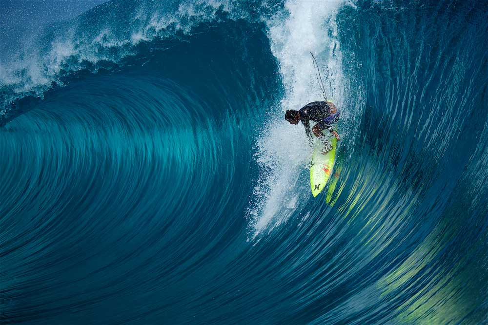 ^ MICHEL BOUREZ  Bourez about to get smashed at Teahupoo on one of the worst wipe-outs he's ever had.     THE SPARTAN, a surfer who knows no fear, a powerful gladiator, relentless charger. Bourez is from a small band of lunatics who will go when others won't dare. He took the latest of late drops on a perfect Teahupoo beast and nearly pulled it off. That evening Michel underwent reconstructive surgery on his broken and mangled hand, into which the surgeon inserted various metal parts –  Commit or be committed .