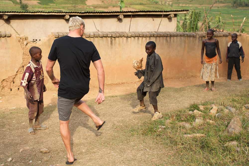 Ball Games with Mick Fanning & local children Rwanda. Copyright © Ted Grambeau 2017