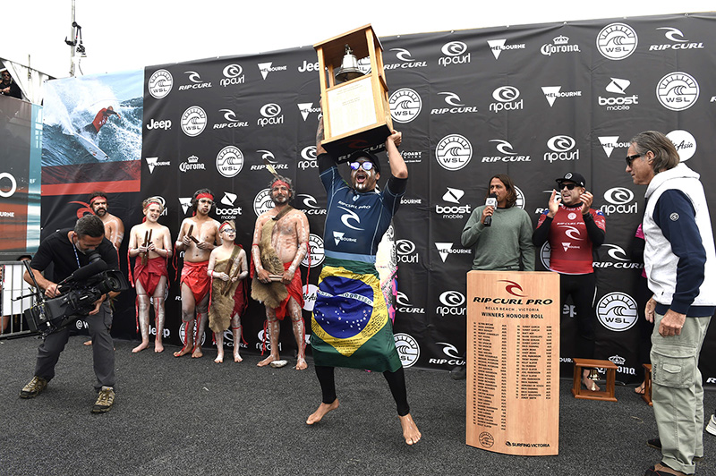 Italo ringing the Bell as Rip Curl co founder Doug (Claw) Warbrick watches on