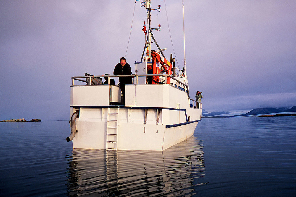 Our captain and his boat, a local fishing vessel before setting off on our expedition.