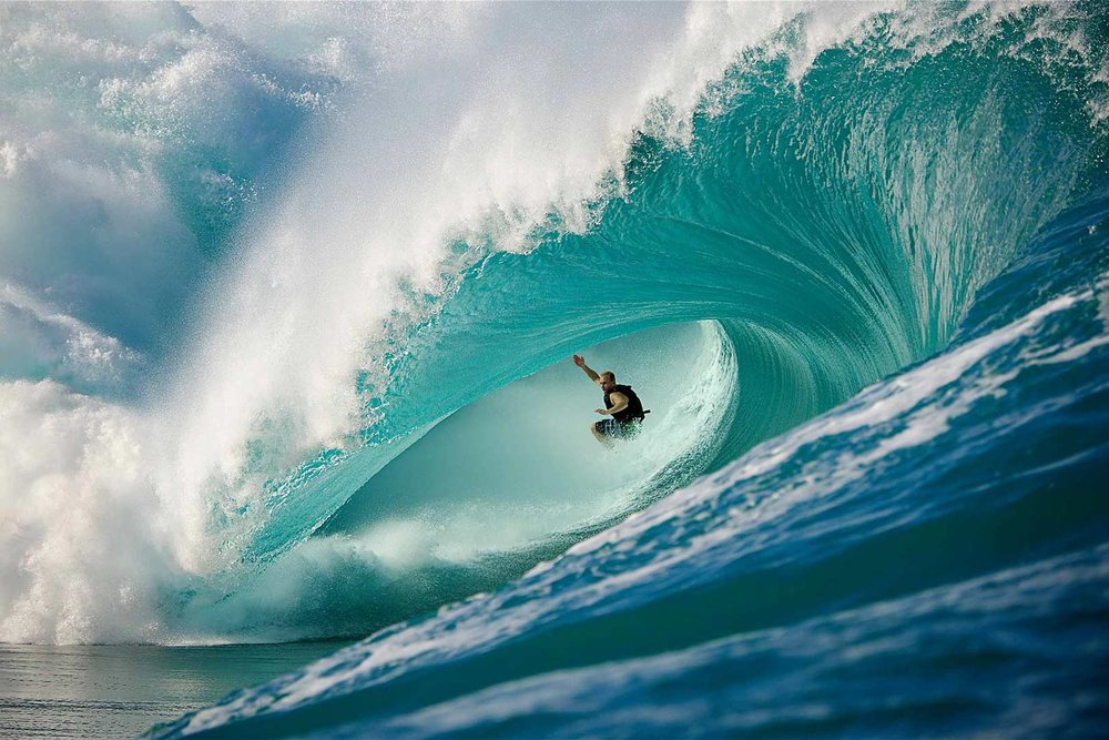 PROFESSIONAL SURF PHOTOGRAPHY Mark Mathews in a Teahupoo vortex