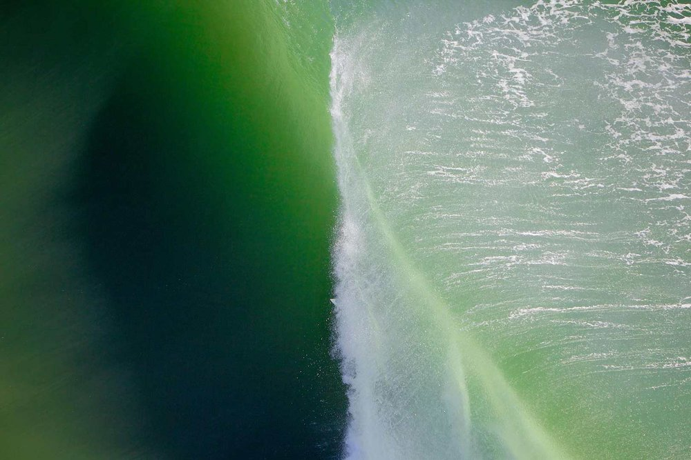 a helicopter view of a surfer at Kirra