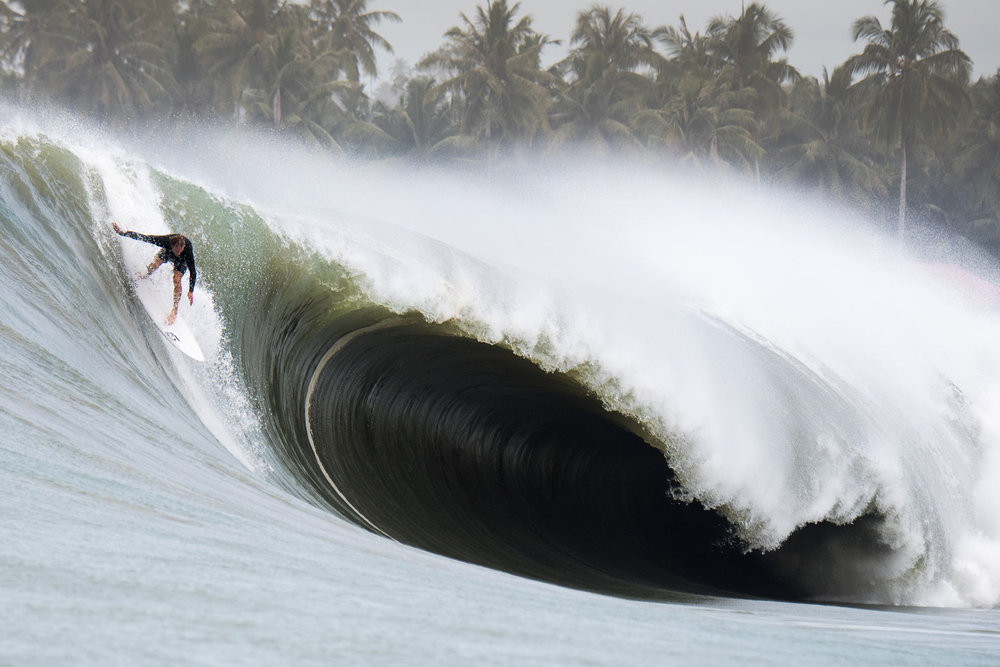 Big Wave Charger Carl Wright dropping into a black hole.