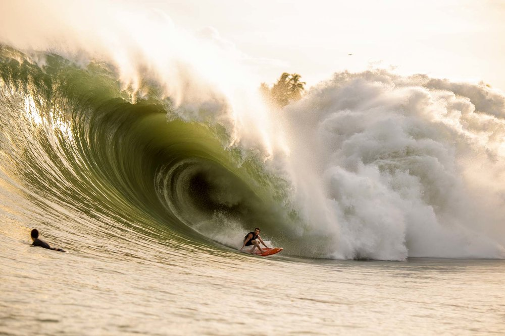 Mark Healey coming off the bottom of one of the biggest waves ridden at Nias.