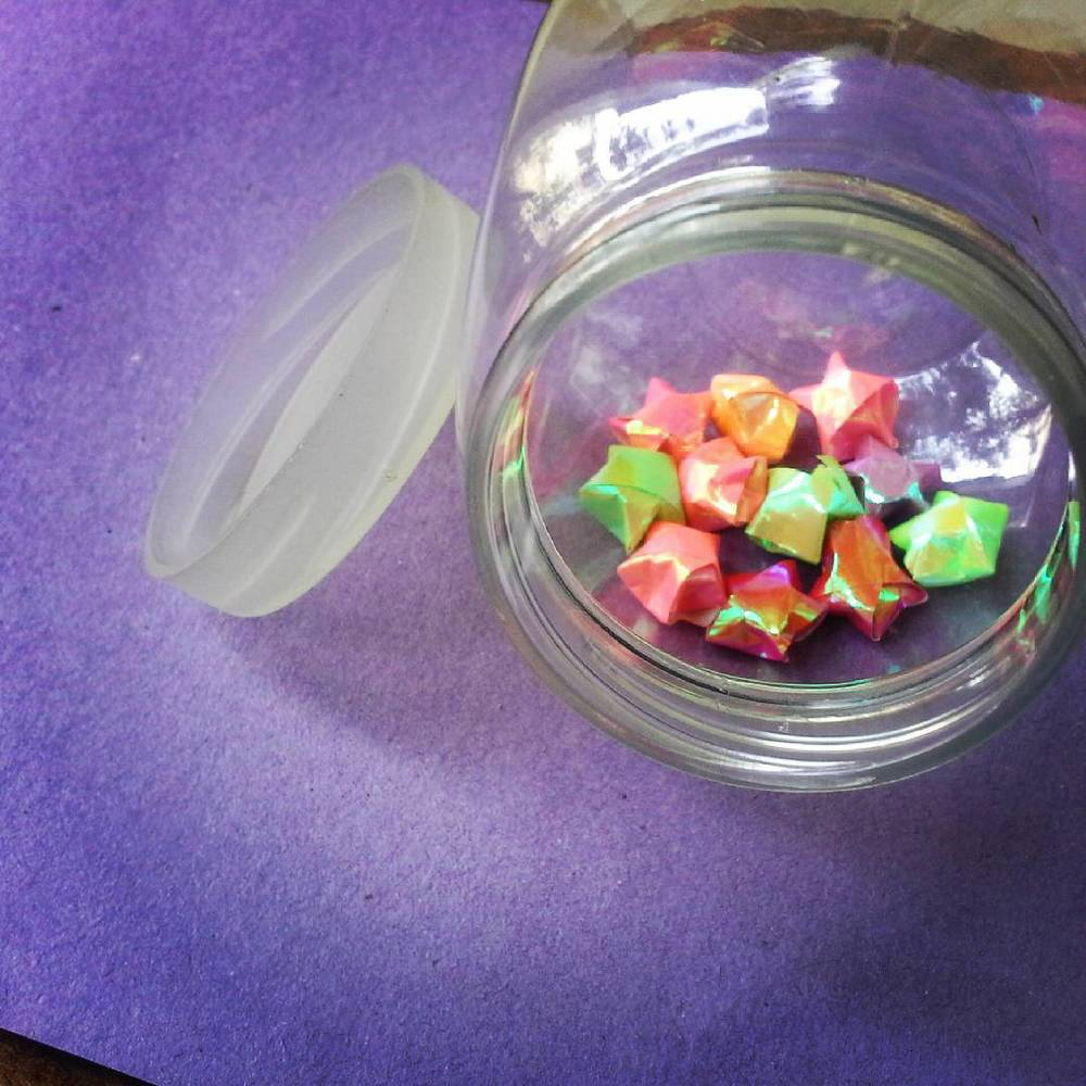 An attempt. I'm trying to fill this little jar with tiny paper stars. Some of the stars are misshapen hehe. If your stars look distorted too, #nevergiveup.