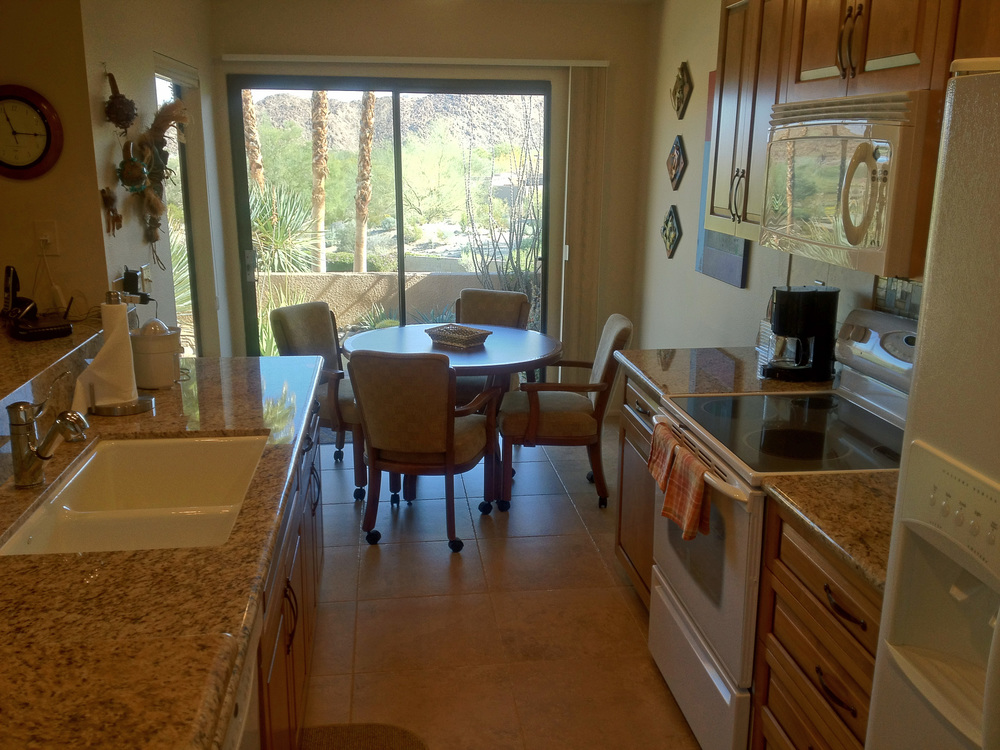 Remodeled kitchen with breakfast room and mountain views