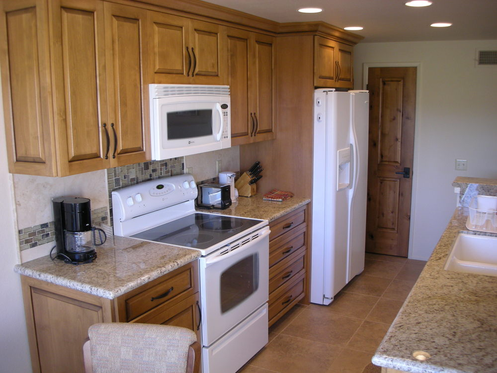 Remodeled kitchen with new appliances and granite countertops