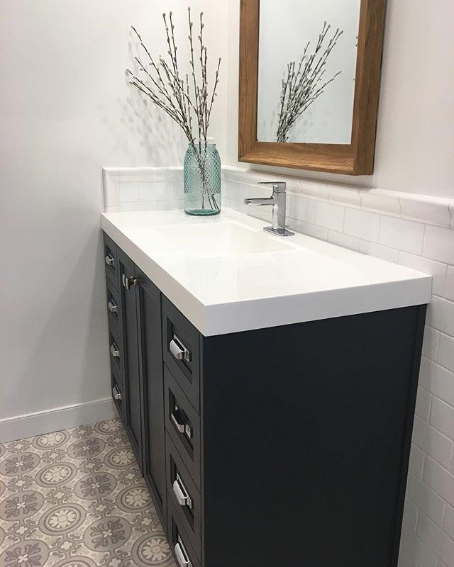 Integrated tile splash, custom vanity, stock countertop
