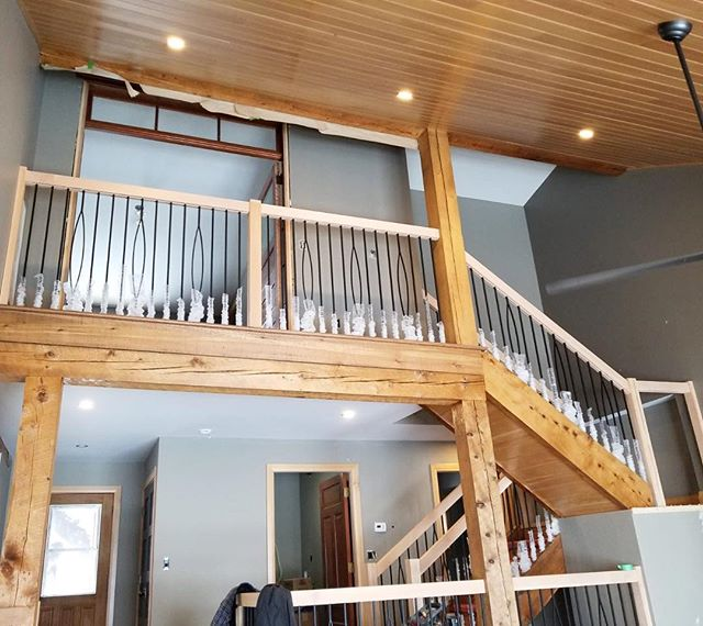 Fir railings with black pickets, fir t&g ceiling, cedar post and beams. . . . . . . . #customhomes #renovations #railing #staircase #customstairs #custommillwork #fir