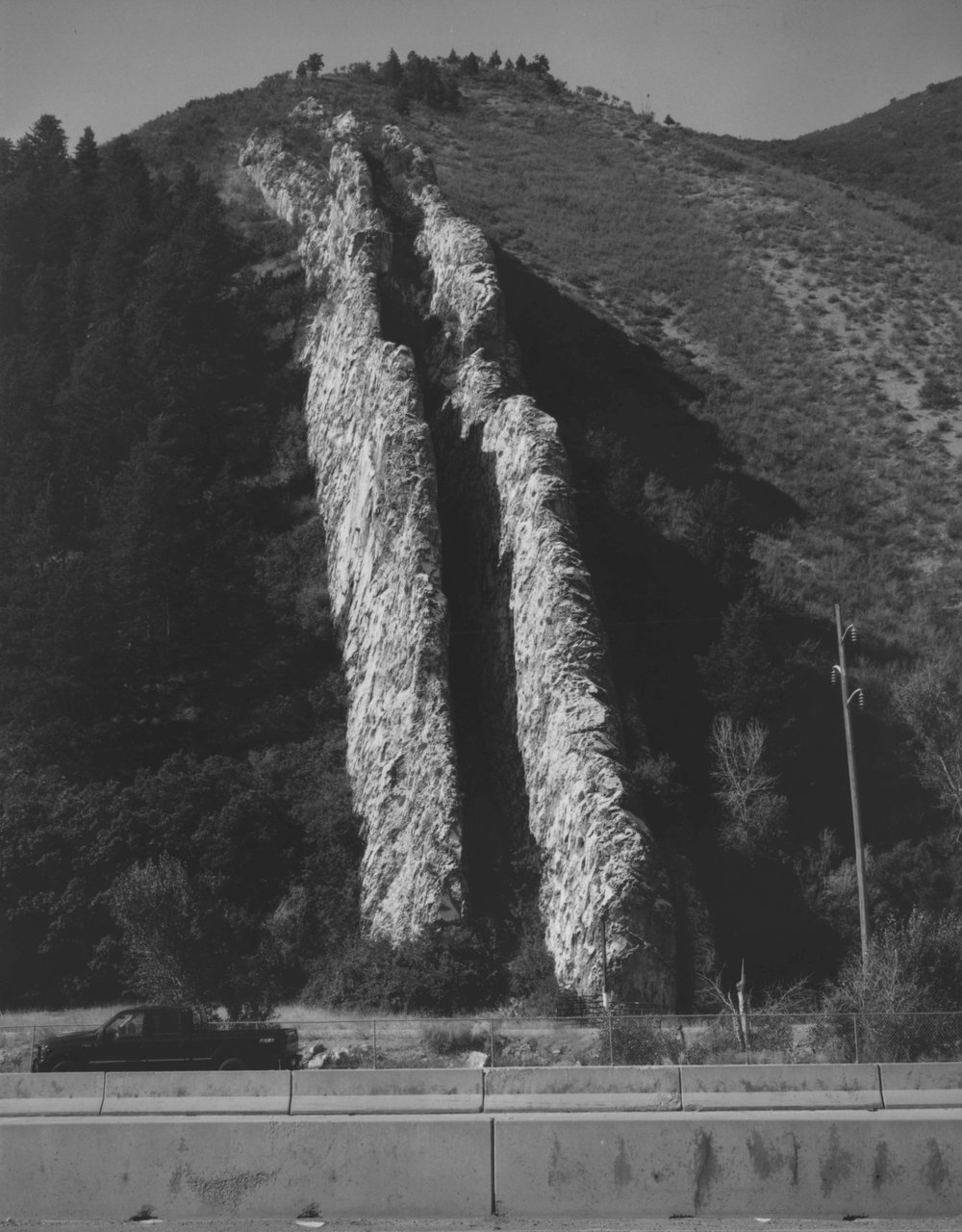 Devil's Slide is a bizarre, giant-size limestone chute, located on the south side of Interstate- 84 in Weber Canyon, Utah.   This site is a tilted remnant of sediments deposited in a sea that occupied Utah's   distant geologic past.