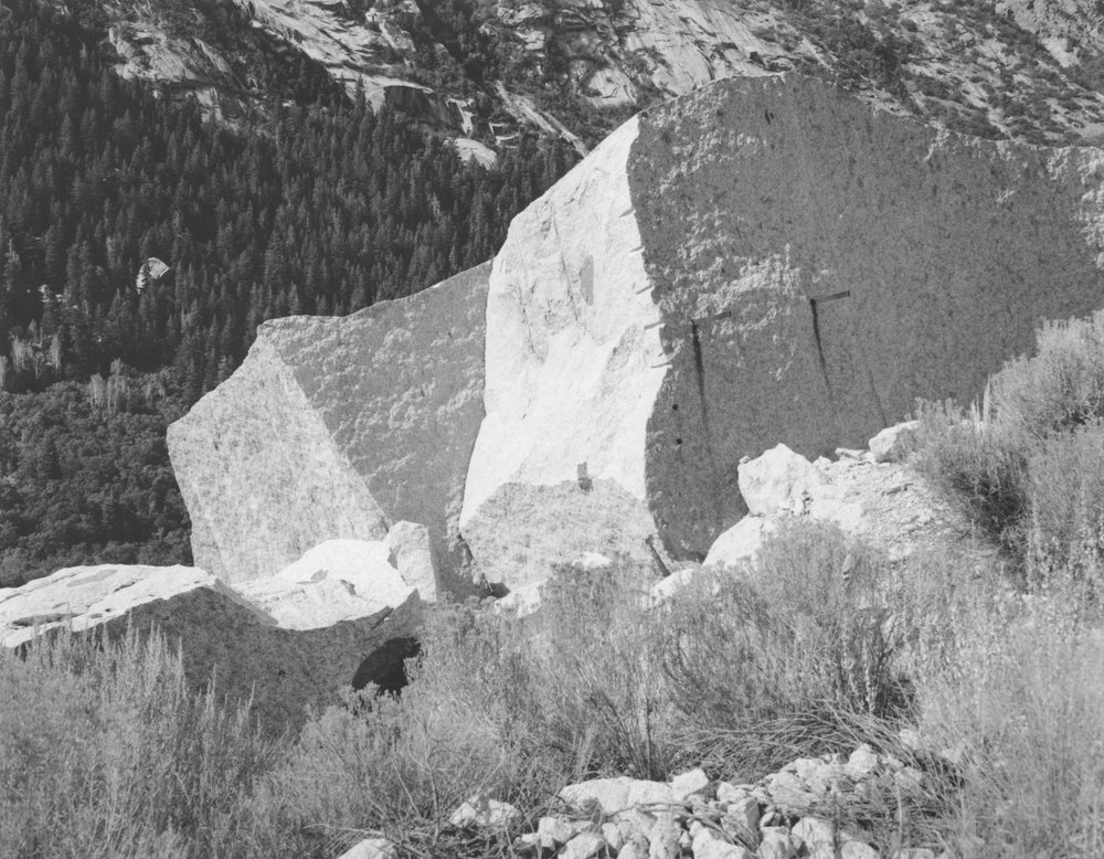 Jagged edges lined with drill holes and scaffold supports reveal the efforts of past Temple quarrymen at the Upper LDS Temple Granite Quarry in Little Cottonwood Canyon, Utah.