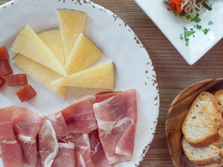 Manchego cheese with cured ham and quince paste is the perfect no-cook tapa.