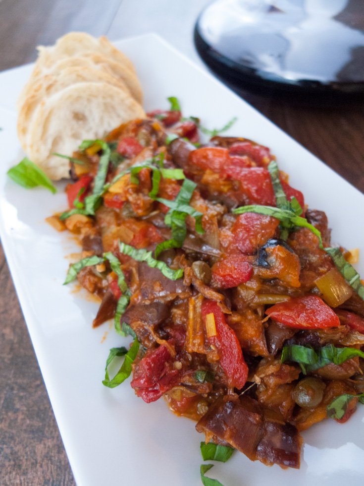 Low FODMAP Eggplant Caponata is easy and healthier than traditional versions. It's a great make-ahead appetizer recipe that also can be morphed into an awesome pasta sauce.