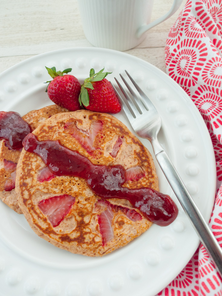 Made with almond meal, oat flour and cornmeal, these strawberry pancakes are satisfying and high protein but still light and tender. They're gluten free and low FODMAP and perfect for a Valentine's Day breakfast. Serve these healthy pancakes with warm jam or go traditional with maple syrup. Click through to get the recipe!