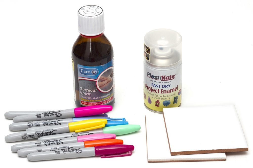 You will need: Sharpie pen markers Tiles (approx. 10cm x 10cm) Surgical Spirit (or alcohol) Varnish Felt Gluegun Scissors White paint