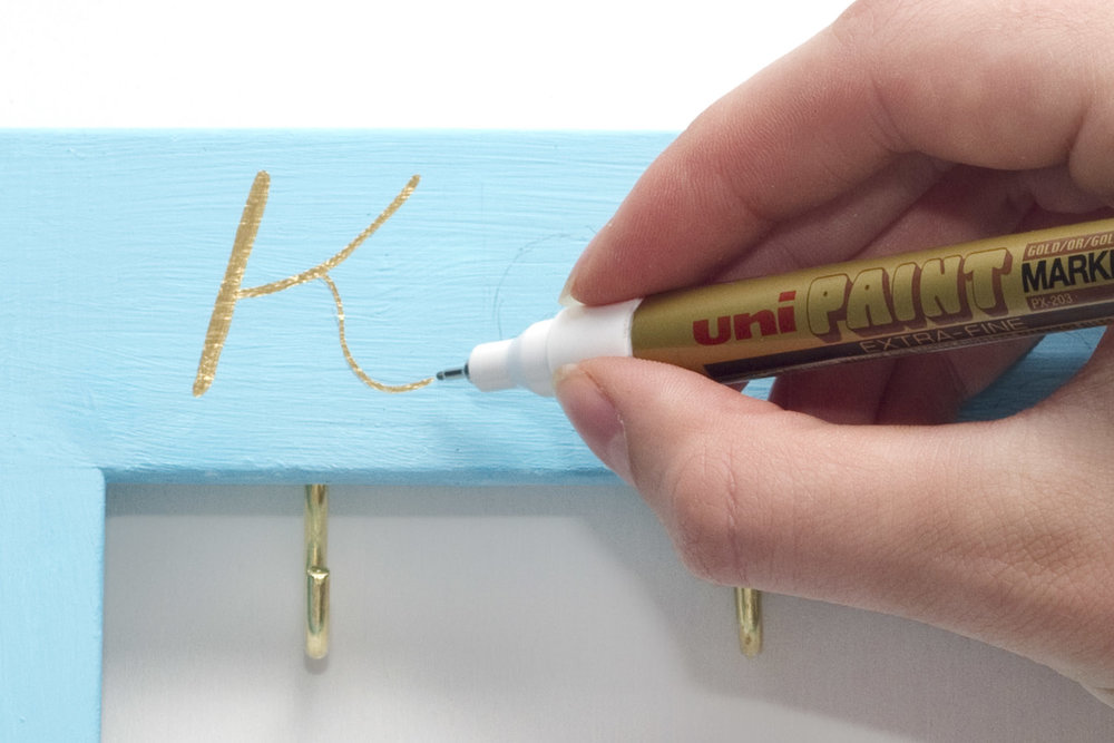 Step 3. Using a pencil, lightly write the word 'keys' on the upper part of the frame, and 'please' on the lower part. Once your happy with the writing, go over it with metallic gold marker - this looks great when it catches the light!  Subscribe to my  newsletter  to receive fun craft ideas weekly!