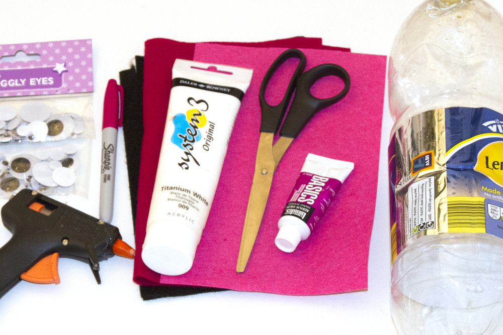 You will need: Large plastic bottle Paint (pink, white) Scissors Felt (dark pink, black) Googly eyes Pen Glue gun (or PVA)