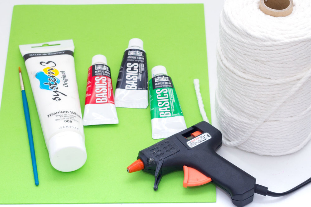 You will need: Rope Gluegun Paint (green, red, white, black) Paintbrush Scissors Foam/felt sheet (green)