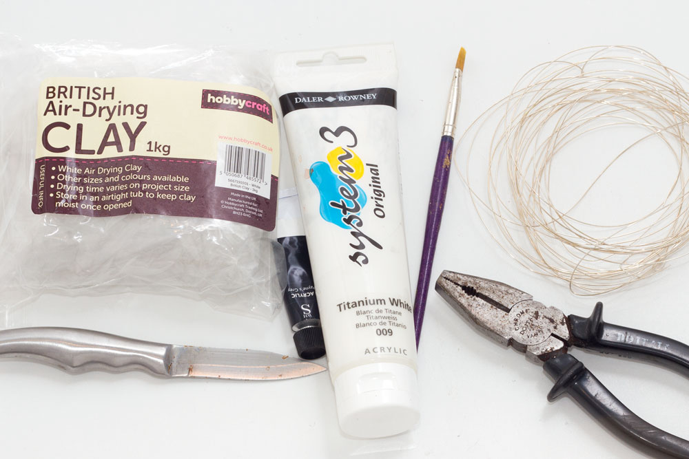 You will need: Clay - I used air dry clay Paint - white, black Paint brush Knife Pliers/wire cutters Wire