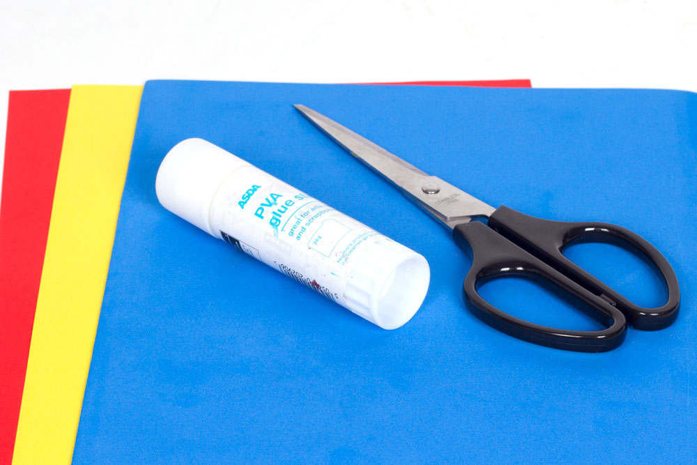 You will need: Coloured paper (red, yellow, white) Foam sheet (blue) Glue Scissors