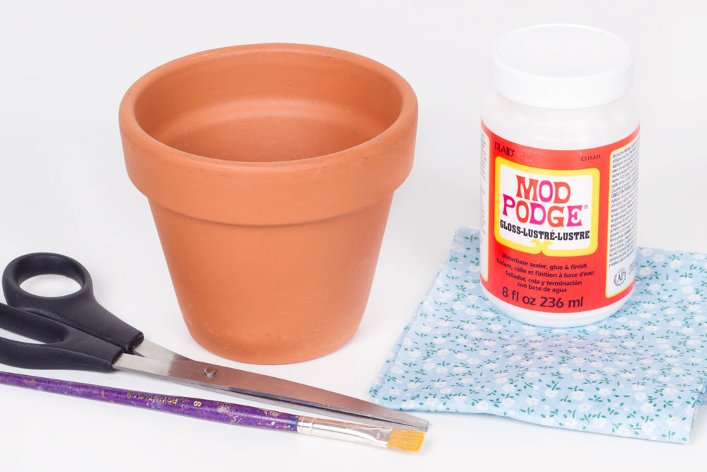 You will need: Plant pot Mod podge Scissors Paint brush Material