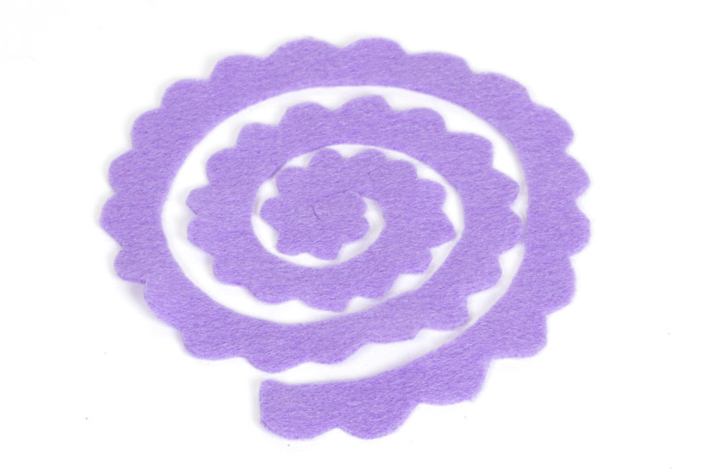 Step 2 Cut a scallop pattern on the outside edge of the entire spiral so it looks similar to the image above. If you want a different look to your felt flowers, such as more pointy petals, then shape the scalloped edge slightly differently.