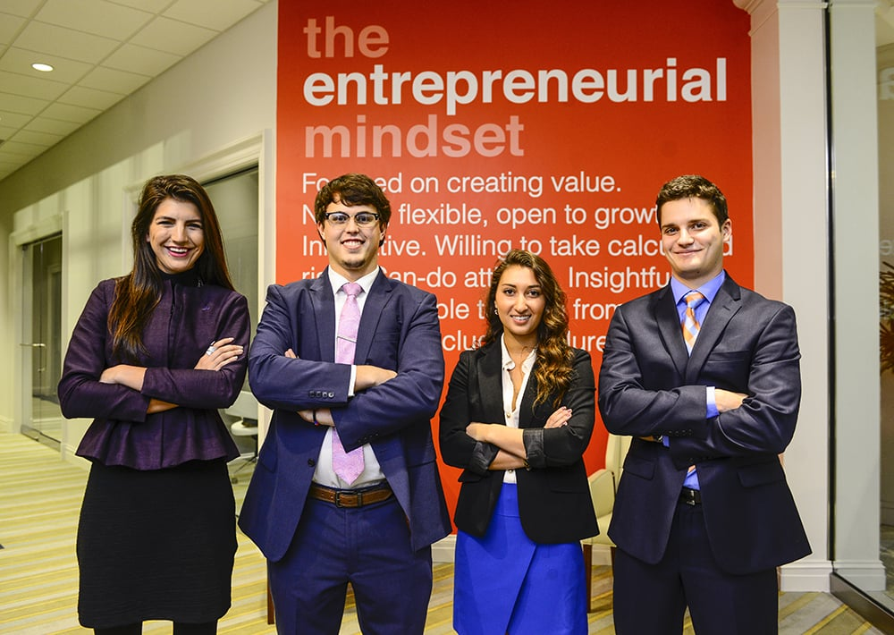 Photo featuring Hannah with the 1st and 3rd Place Winners of High Point University 's Entrepreneurship Pitch Competition