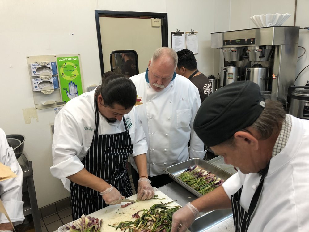 May 2, 2018: Kix Nystrom and his Cheesecake Factory executive kitchen staff working along side GrowGood culinary students preparing lunch for shelter residents.  Many of the dishes served that day utilized produce from the farm, including our onions pictured above.