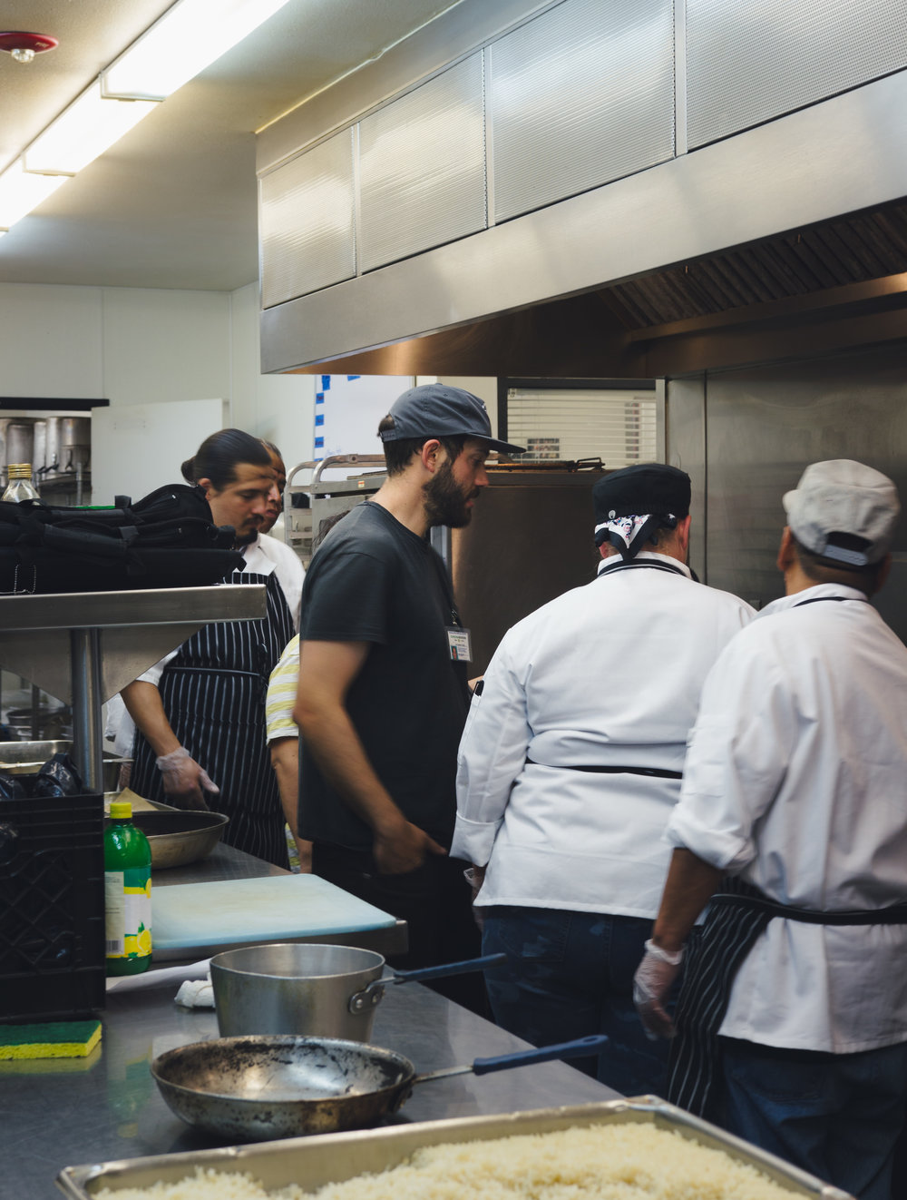 Chef and farmhand Eric Tomassini pictured middle wearing black