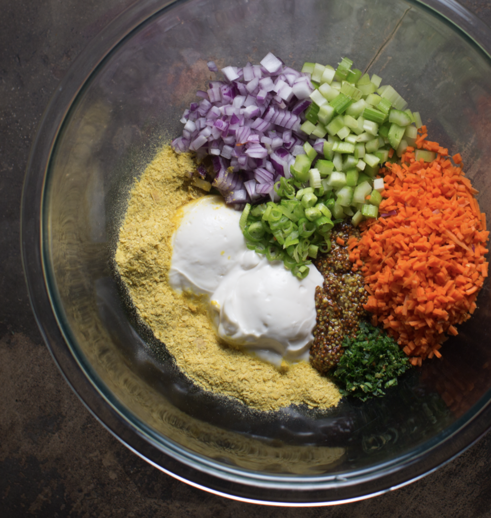 Here are all the dressing ingredients in one large bowl. And here's a little tip:place everything in piles when combining. This way you can make sure you have all ingredients in the bowl before mixing together. And it looks cool! : )