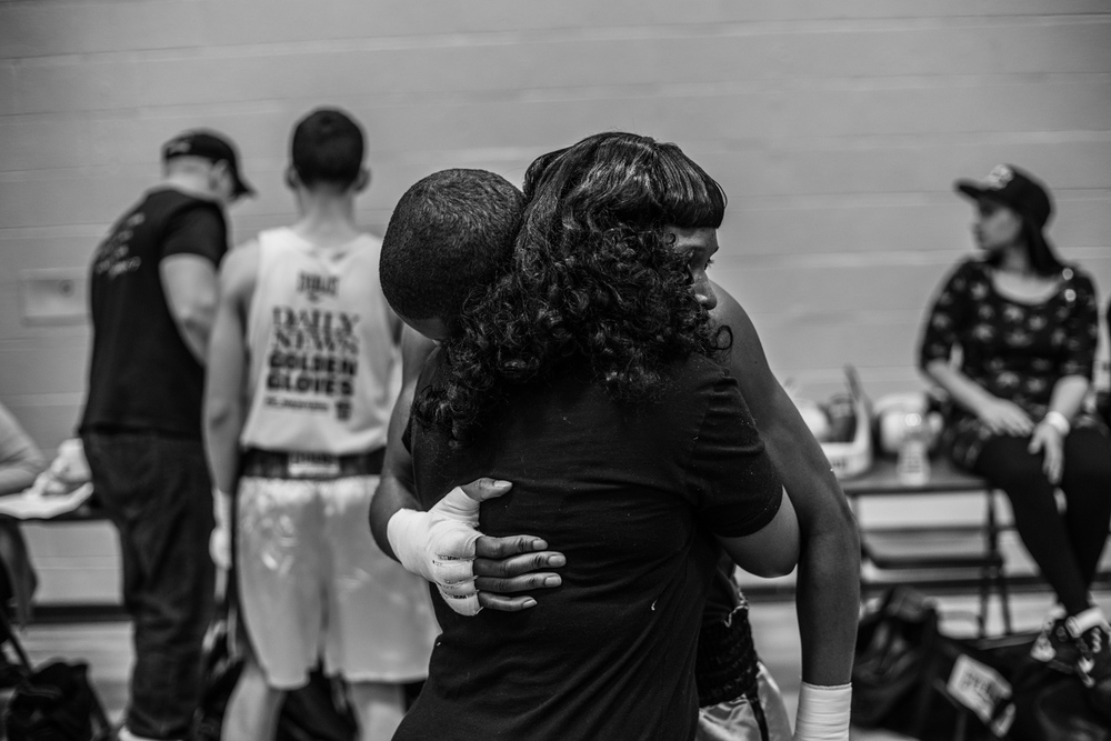 """I worry about him every time he fights.""  Kelly Simpkins. Shu Shu's mother, hugs her son before his Golden Gloves fight in Holy Cross High School, 26-20 Francis Lewis Boulevard, Flushing, Queens."