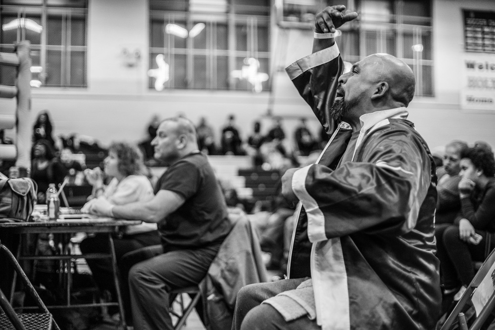 """That's it baby!  Left jab!""  Aureliano Sosa, head coach at Flatbush Gardens boxing club, giving advice from the corner at Shu Shu's fight in Holy Cross High School, Queens on March 6, 2015."