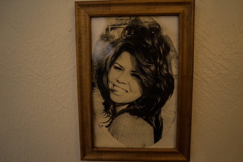 A photograph of a younger Cristine hanging on the wall of her home in Casitas Court, Tampa, Florida.