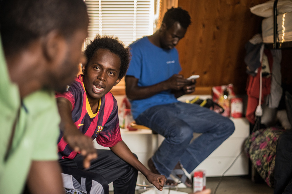 """I witnessed a slave trade in Libya.""  Here Mohamed Jallow (25) had just shown me scars of where he had been beaten while in Libya with canes and sticks over his head and body.  ""If I had money, I would not have left The Gambia to come here.  My family are Gambian and I was born in Sierra Leone.  We returned to The Gambia after civil war started in Sierra Leone.""  The Gambia, as one of the smallest countries in the world, has few natural resources, subject to global price fluctuations of peanuts, its largest export.  People often migrate seeking better job prospects.  For others, they flee persecution from the dictatorship."