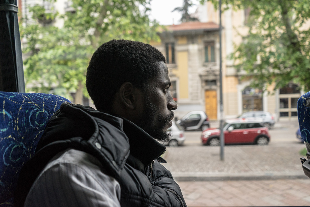 Momodou Van Bah (26), from the Gambia, on a bus in Milan's city center.
