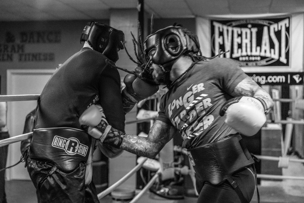 "Two local men spar with each other.  The club has great camaraderie where all people are welcome.  ""We struggling man"", says Nate.  ""The cost of heating this place, the upkeep of the gym, simple things, it all costs money."""