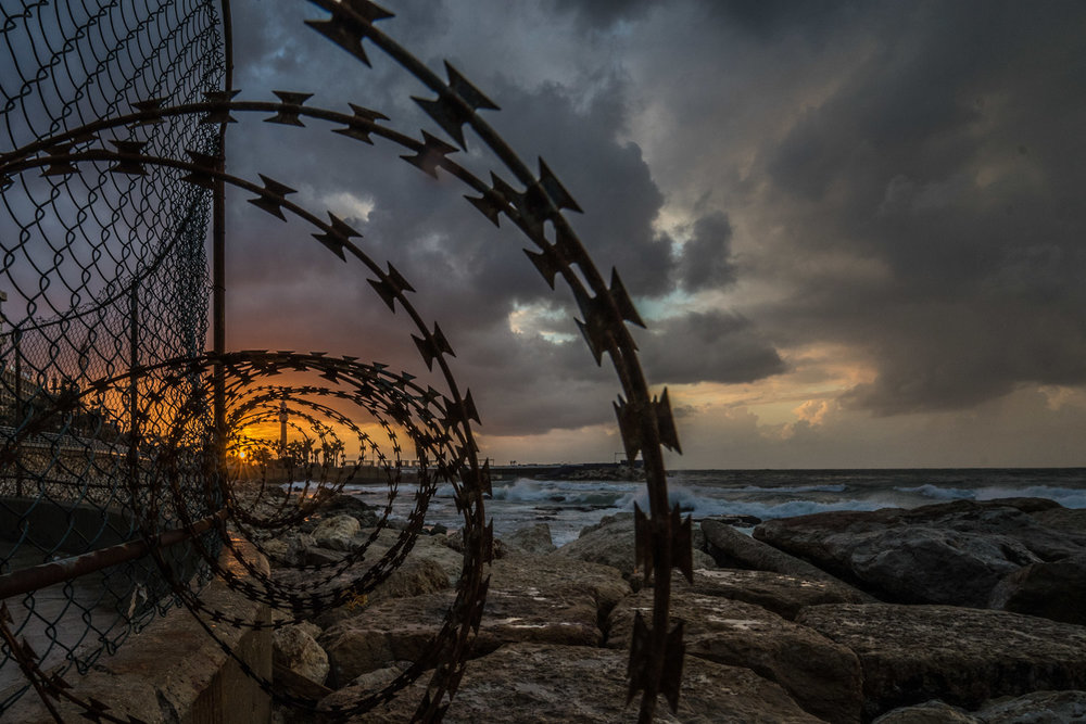 With the privatization of public lands, there are few public spaces for people to access the sea without having to pay.  Barbed wire stops people from accessing a privately owned section of Beirut's coastline.