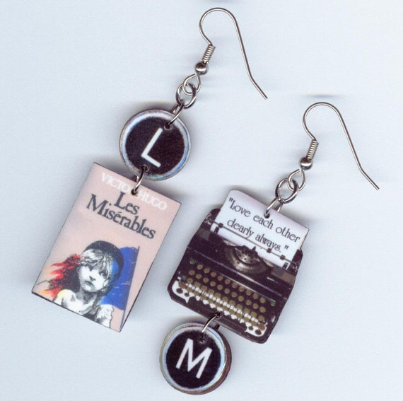 - Play it by Ear: What better way for her to proclaim her devotion to a favorite author or book? Custom Orders available. $18https://www.etsy.com/listing/195961661/book-cover-earrings-les-miserable-quote