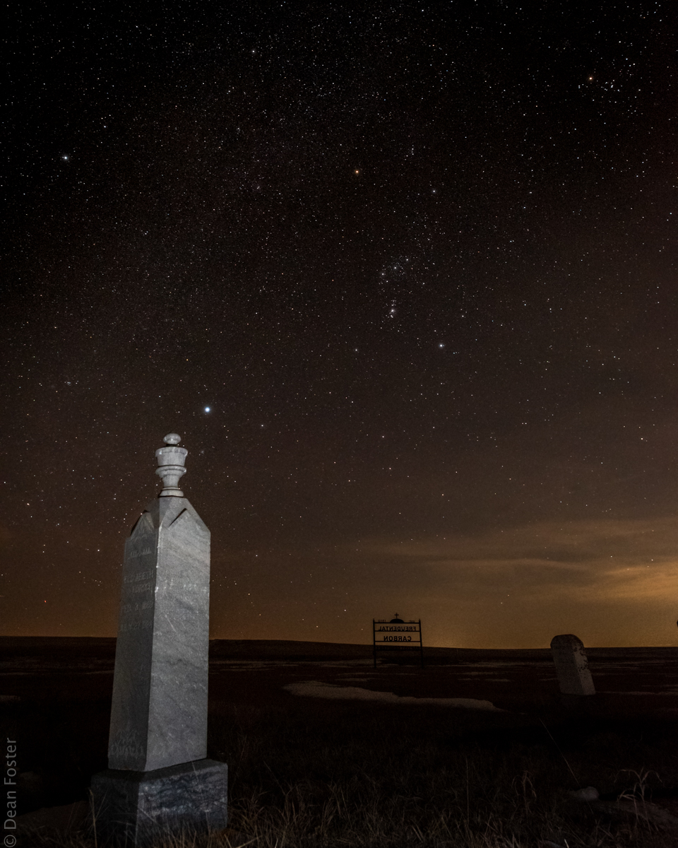 Orion rises over a small cemetery near Carbon, Alberta