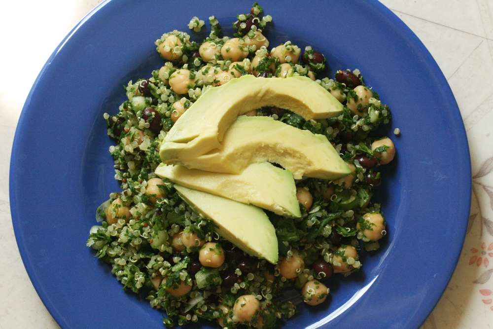 Homemade salad of chickpeas, quinoa, black beans, parsley, and avocado.
