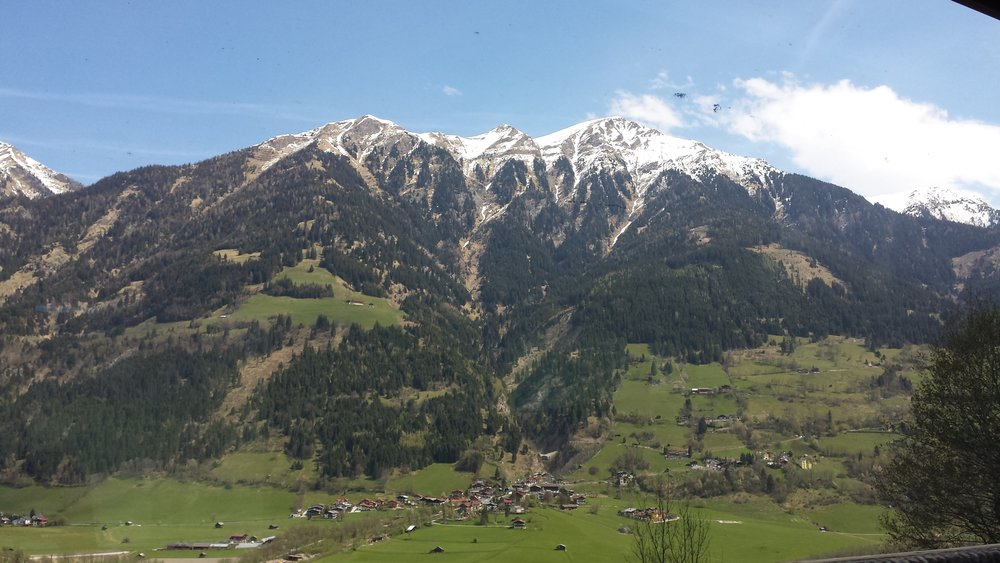 The Austrian Alps through the window of a train.