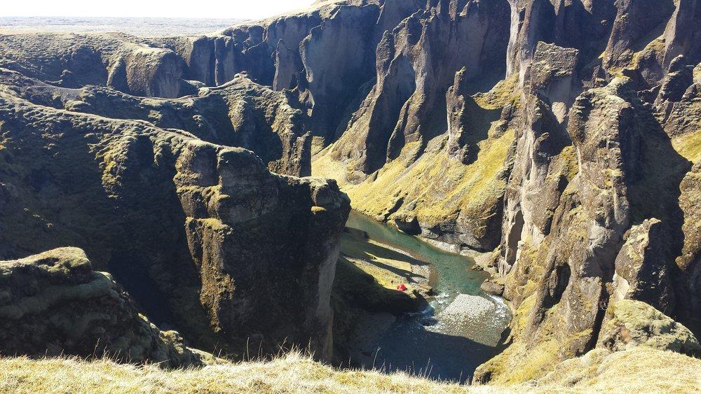Fjaðrárgljúfur canyon on a sunny day.