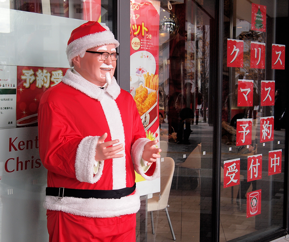 Colonel Sanders' signature Christmas outfit. Remind you of anyone? The resemblance is uncanny! Photo by Mark.